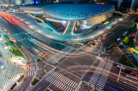 Late night traffic blurs past Dongdaemun Design Plaza in Seoul , South Korea.