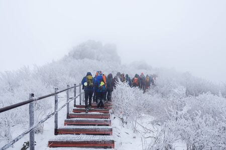 Hiking in the winter with a lot of fog.winter mountains landscape snow in korea