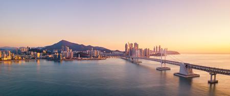 Gwangan Bridge and Haeundae aerial view at Sunrise, Busan, South Korea
