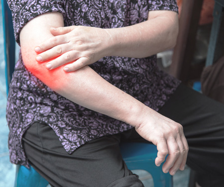 rupture: closeup woman elbow pain. arm pain and injury concept.