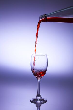 Pour pomegranate juice into a glass. photo