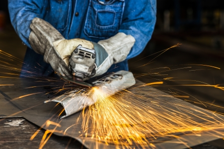 grinding sparks in a heavy industry workshop  Stock Photo