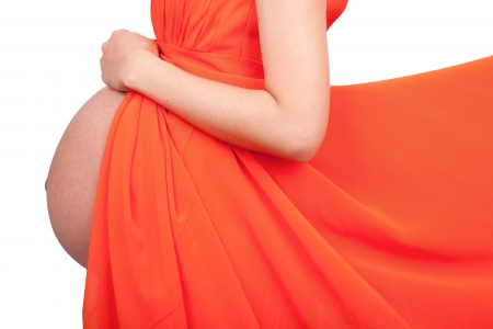 Pregnant people dress in orange on a white background photo