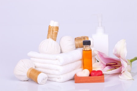 Spa and wellness setting with natural soap, candles and towel photo