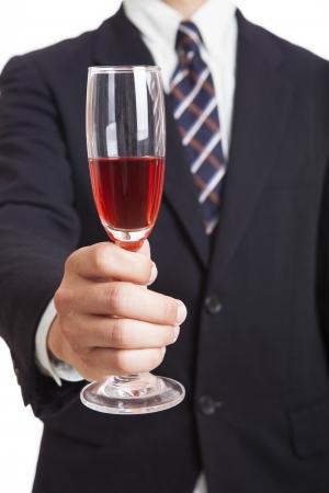 Businessman holding wine photo
