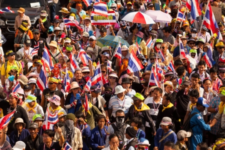 rightwing: BANGKOK, Thailand - January 9, 2014  Protesters march through the Thonburi area to join a large anti-government rally on January 9, 2014 in Bangkok, Thailand  The group protesters Invite people to join the protests on 13 January 2014