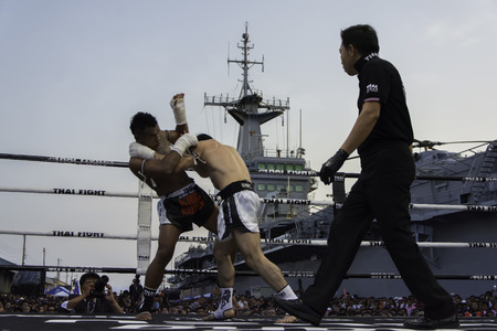 unrivalled: SATTAHIP, THAILAND- APRIL 6 : Between the punch  in Thai Fight : Muay Thai..Worlds  between Kaew Fairtex (Thailand) VS Enkhamar Batbayar (Brazil) in Thai Fight : Muay Thai..Worlds Unrivalled Fight on April 6, 2014 at King of muay thai , Chonburi , Thail