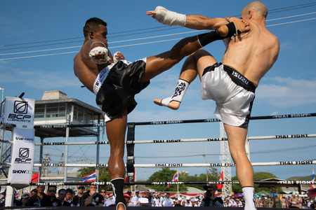 unrivalled: SATTAHIP, THAILAND- APRIL 6 : Between the punch  in Thai Fight : Muay Thai..Worlds  between Sueadam khongsittha Muay Thai (Thailand) VS Christophe TarTari (France) in Thai Fight : Muay Thai..Worlds Unrivalled Fight on  April 6, 2014 at King of muay thai Editorial