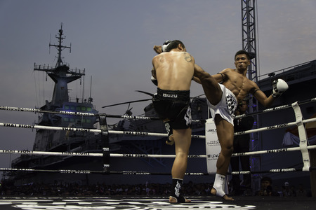 unrivalled: SATTAHIP, THAILAND- APRIL 6 : Between the punch  in Thai Fight : Muay Thai..Worlds  between Saiyok Pumpanmuang (Thailand) VS Chanajon P.K.Sanchai Muay Thai Gym (Thailand) in Thai Fight : Muay Thai..Worlds Unrivalled Fight on April 6, 2014 at King of mua Editorial