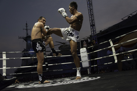 unrivalled: SATTAHIP, THAILAND- APRIL 6 : Between the punch  in Thai Fight : Muay Thai..Worlds  between Saiyok Pumpanmuang (Thailand) VS Chanajon p.k.Sandchai Muay Thai Gya (Thailand) in Thai Fight : Muay Thai..Worlds Unrivalled Fight on April 6, 2014 at King of mu