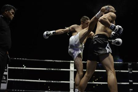 SATTAHIP, THAILAND- APRIL 6 : Between the punch  in Thai Fight : Muay Thai..Worlds  between Antoine Pinto (France) VS Alan Ryan (Scotland) in Thai Fight : Muay Thai..Worlds Unrivalled Fight on April 6, 2014 at King of muay thai , Chonburi , Thailand