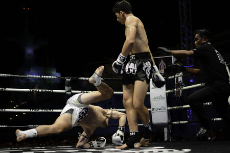 unrivalled: SATTAHIP, THAILAND- APRIL 6 : Between the punch  in Thai Fight : Muay Thai..Worlds  between Antoine Pinto (France) VS Alan Ryan (Scotland) in Thai Fight : Muay Thai..Worlds Unrivalled Fight on April 6, 2014 at King of muay thai , Chonburi , Thailand