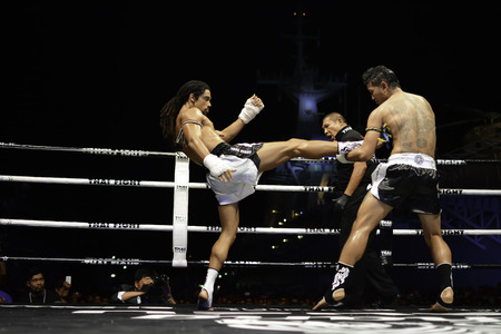 SATTAHIP, THAILAND- APRIL 6 : Between the punch  in Thai Fight : Muay Thai..Worlds  between Sudsakorn Sor.Klinmee (thailand) VS Cody Moberly (canada) in Thai Fight : Muay Thai..Worlds Unrivalled Fight on April 6, 2014 at King of muay thai , Chonburi , T Editorial