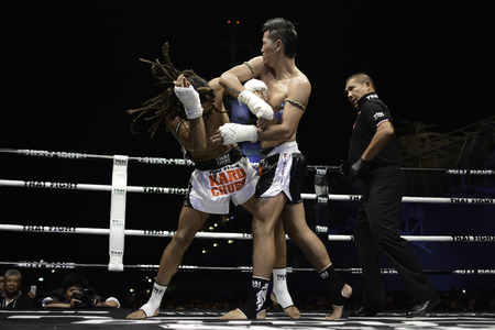 cody: SATTAHIP, THAILAND- APRIL 6 : Between the punch  in Thai Fight : Muay Thai..Worlds  between Sudsakorn Sor.Klinmee (thailand) VS Cody Moberly (canada) in Thai Fight : Muay Thai..Worlds Unrivalled Fight on April 6, 2014 at King of muay thai , Chonburi , T Editorial
