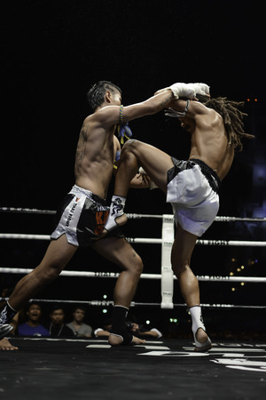 unrivalled: SATTAHIP, THAILAND- APRIL 6 : Between the punch  in Thai Fight : Muay Thai..Worlds  between Sudsakorn Sor.Klinmee (thailand) VS Cody Moberly (canada) in Thai Fight : Muay Thai..Worlds Unrivalled Fight on April 6, 2014 at King of muay thai , Chonburi , T Editorial