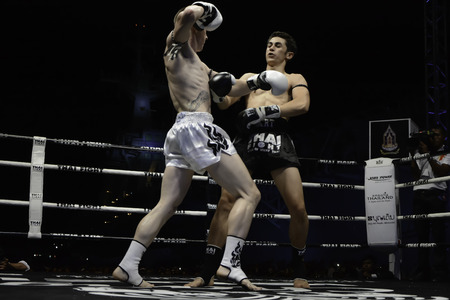 unrivalled: SATTAHIP, THAILAND- APRIL 6 : Between the punch  in Thai Fight : Muay Thai..Worlds  between Leo Pinto (France) VS Cody Moberly (USA) in Thai Fight : Muay Thai..Worlds Unrivalled Fight on April 6, 2014 at King of muay thai , Chonburi , Thailand