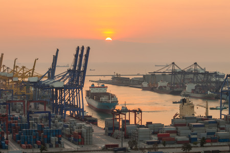 commercial: sea port with the sunrise in the morning.
