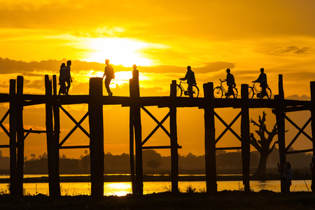The guy with the shiny black bike on U Bein Bridge. Stock Photo