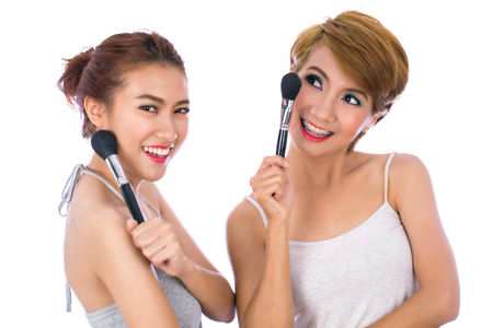 The two women with makeup isolated background.