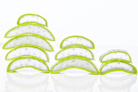 Aloe vera leaves with slices on white background.