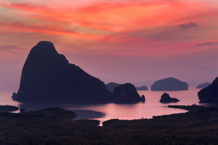 Dramatic sunrise over the mountains and the sea  in Thailand. 写真素材