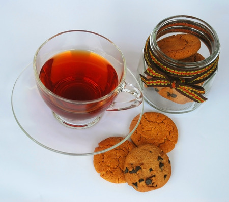 Hot tea in glass cup with chocolate chips cookies photo