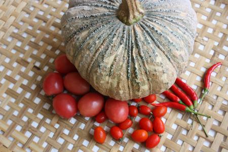 threshing: pumpkin and red garden vegetables on the threshing basket
