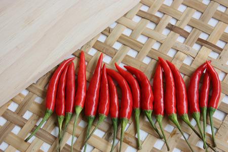 threshing: red chili decorate on threshing basket and wood background