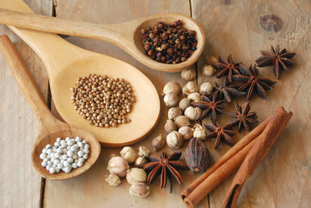 chinese herbs: various spices for chinese food boiled decorate on ladle and wooden background