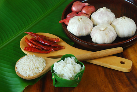 thai chili pepper: Various ingredients for cooking thai food including red onion, garlic, dry chili, jasmine rice and cooked rice. This is thai traditional lifestyle.