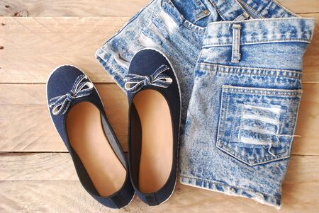 twain: accessories jean style of young women, including a denim shorts, and dark blue shoes