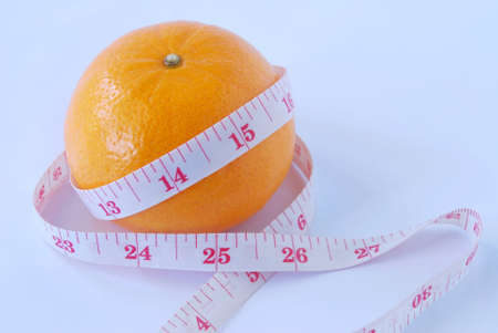 orange peel skin: Concept of body shape and skin using a orange peel rough for symbolize of skin and cellulite. Stock Photo