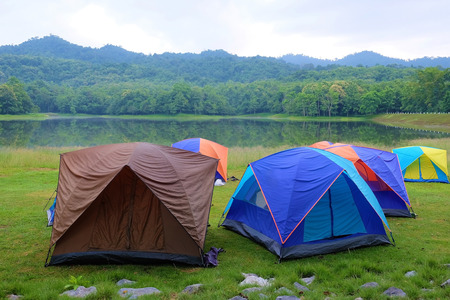 Tents of tourists camping in the national park during the rainy season in Thailand. Stock Photo