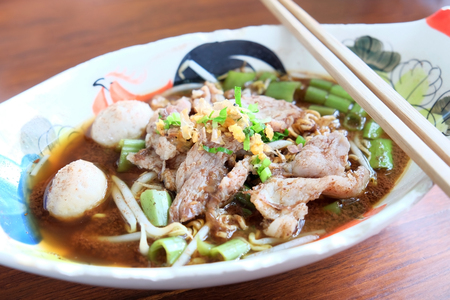 Thai traditional food are noodles, pork and meatballs made from pork in the soup. Stock Photo