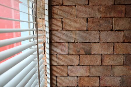 Brown brick walls in retro style and shaded windows come from the curtain in the daytime.