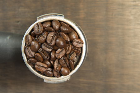 Stil: Coffee beans in the coffee tablet. Stil life style. Stock Photo