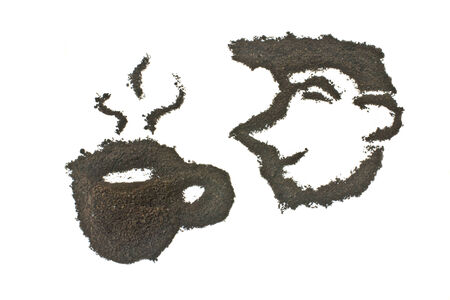 coffee grounds: Coffee grounds, face and coffee cup shape. Stock Photo