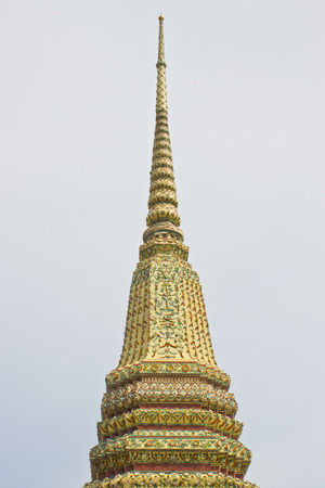 no name: Pagoda in Wat Pho or Wat Phra Chetuphon, the Temple of the Reclining Buddha. In Thailand public domain or treasure of Buddhism. no copyright, no name of artist appear.