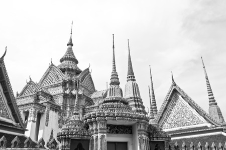no name: Wat Pho or Wat Phra Chetuphon, the Temple of the Reclining Buddha monochrome. In Thailand public domain or treasure of Buddhism. no copyright, no name of artist appear.