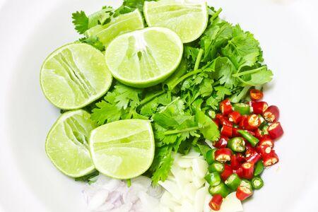 seasoning: Lemon slice, chili garlic shallot and coriander chopped, seasoning, ingredient