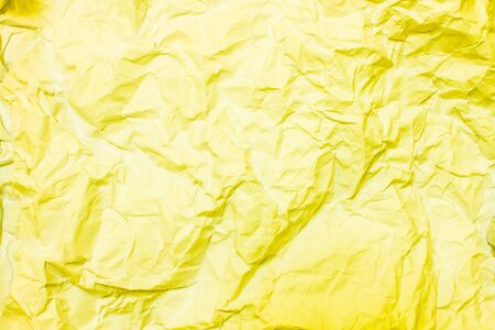 wrinkled paper: Yellow crumpled paper, wrinkled paper Stock Photo