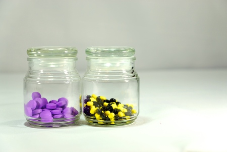 nursing bottle: two different type of medicines in glass jars Stock Photo