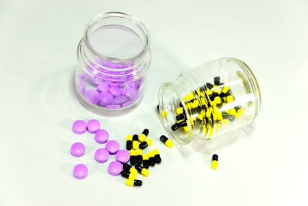 two different type of medicines in glass jars photo