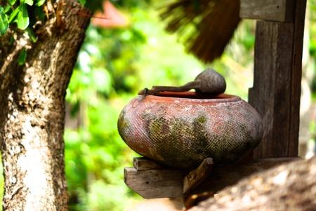 earthen: old earthen water containing pot in thai style garden