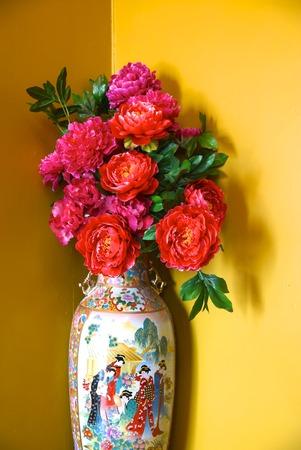 botan: pink botan flowers on chinese style jar
