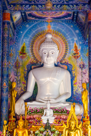 white Buddha image in temple hall,Chiangrai,Thailand