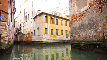 Antique colorful house along the venice canal Imagens - 79423858