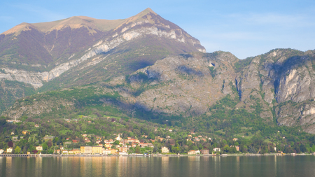 lake como with mountain and blue sky background Imagens