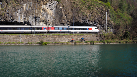 European train move along the river Interlaken Imagens