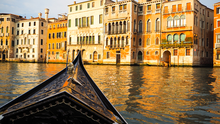 Gondola in Grand Canal with beautiful building at sunset Imagens